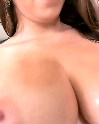 Revealing her bouncing large tits with pleasure
