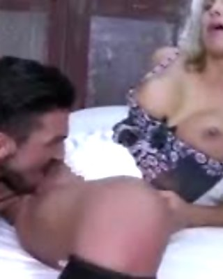 Blondie in hot lingerie gets on her knees to suck a big bone