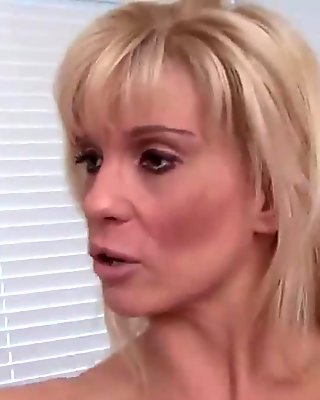Handsome blonde MILF presents her big pair of tits solo