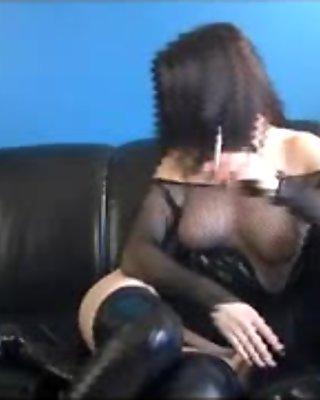 Aroused busty brunette bimbo rubbing