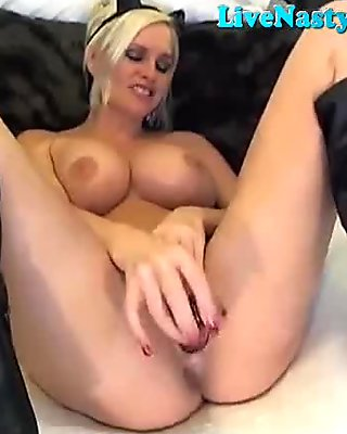 Big tits blonde in leather boots toying her pussy on webcam
