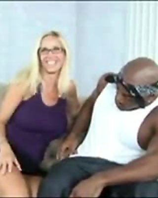 Busty blonde having interracial sex