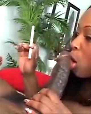 Lusty ebony babe does smoke rings on big black cock