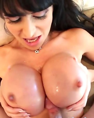 Busty milf fucking a cock with her bigtits