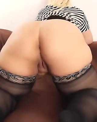 Big beautiful mature blonde plays with her chubby big boobs